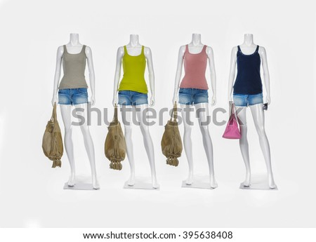 Full length four female mannequin with colorful shirt in short jeans  - stock photo