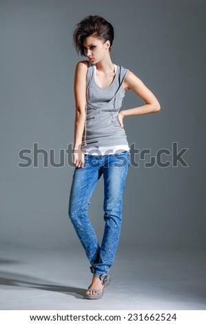 full-length girl in jeans, posing standing isolated posing  - stock photo