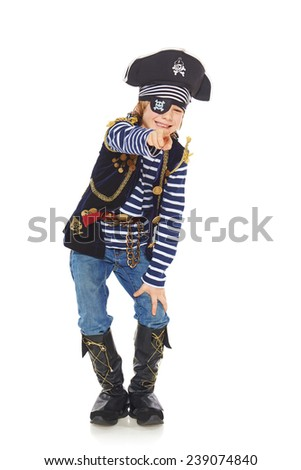 Full length grinning little boy wearing pirate costume pointing at camera, over white background