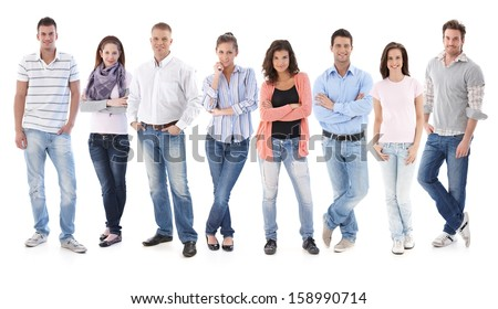 Full-length group portrait of happy young casual people standing side by side, looking at camera, smiling. - stock photo