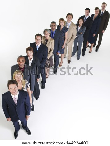 Full length group portrait of multiethnic businesspeople in a row against white background - stock photo