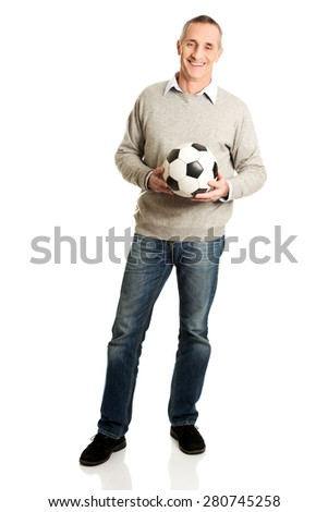 Full length happy mature man with a soccer ball. - stock photo