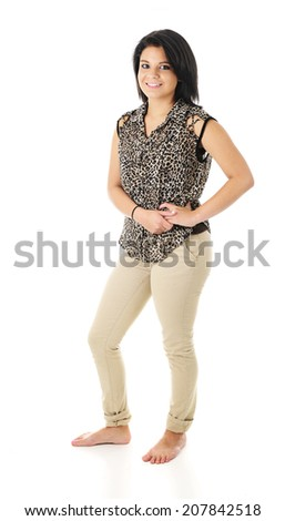 Full-length image of a beautiful, barefoot teen girl, smiling at the viewer.  On a white background. - stock photo