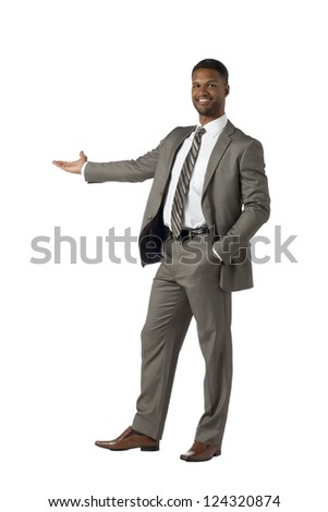 Full length image of a businessman extending his hand to present something over a white background - stock photo