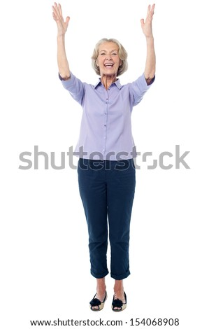 Full length image of a happy senior citizen - stock photo