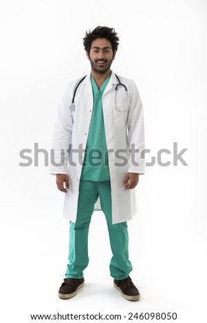 Full length image of a Male Indian doctor wearing Green Scrubs. Isolated on white background. - stock photo