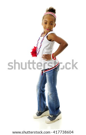 Full length image of a sassy elementary girl proudly wearing her red, white and blue.  On a white background. - stock photo