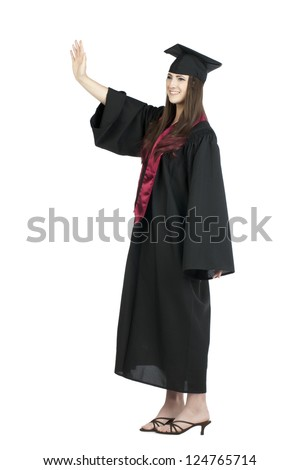 Full length image of a waving female graduate