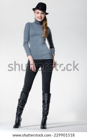 Full length image of an attractive young girl posing on white background - stock photo