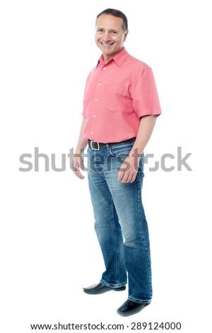 Full length image of casual senior man posing - stock photo