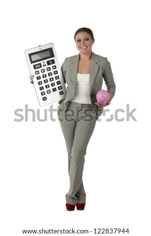 Full length image of cheerful accountant carrying a giant calculator and piggy bank over a white background - stock photo