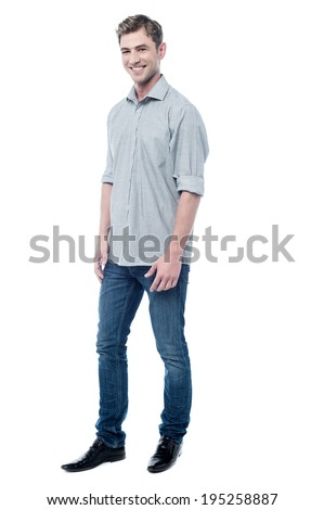 Full length image of smiling young man