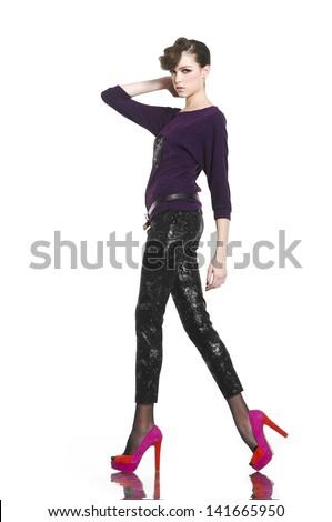 Full length image of young fashion model walking - stock photo
