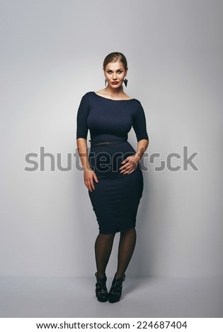 Full length image of young woman posing confidently. Curvy female model proud with her body - stock photo
