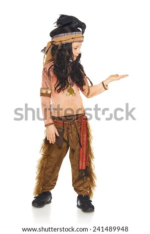 Full length little boy in a suit of the indian showing open hand palm with copy space for product or text, on a white background - stock photo