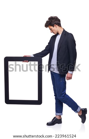 Full length man holding empty frame - copy space for text, over white background