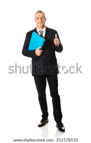 Full length mature businessman with ok sign.
