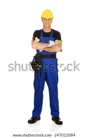Full length mature worker with folded arms. - stock photo