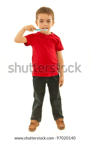 Full length od small boy holding toothbrush isolated onw hite background