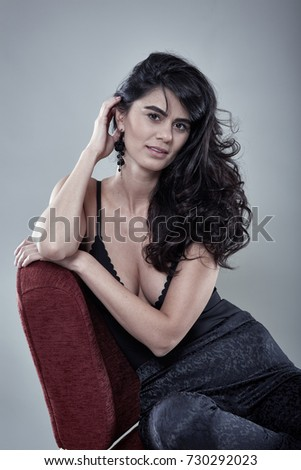 Full length of a beautiful female glamour model on gray background