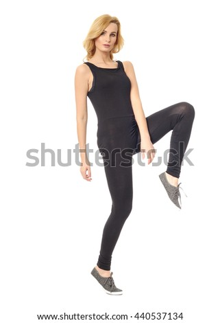 Full length of a beautiful young woman in overall standing over white - stock photo