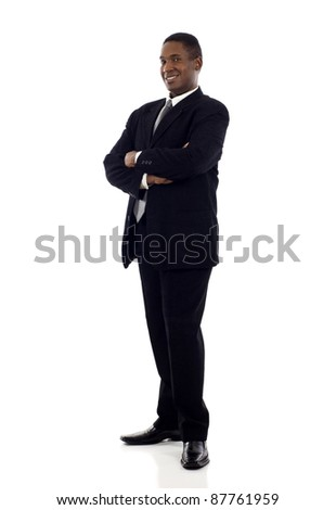 Full length of a confident African American businessman standing with his hands crossed isolated white background