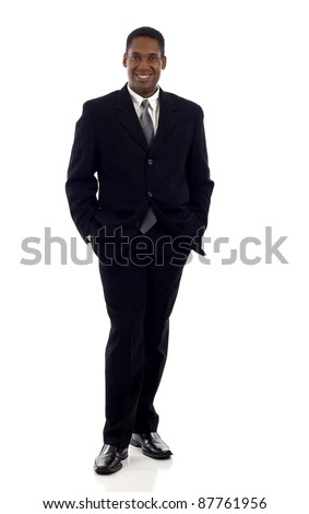 Full length of a confident African American businessman standing with his hands in pockets isolated white backgroun