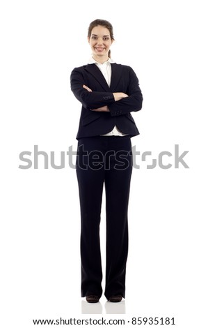 Full length of a confident young business woman standing with folded hands isolated on white background - stock photo
