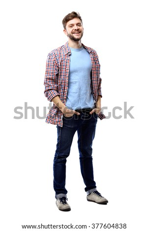Full length of a cute young man in jeans and t-shirt looking at the camera, against white background - stock photo