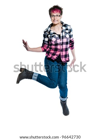Full length of a funky nervous casual young woman jumping in studio on white isolated background - stock photo