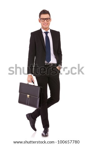 Full length of a handsome business man standing with hands in pocket and holding a briefcase against white - stock photo