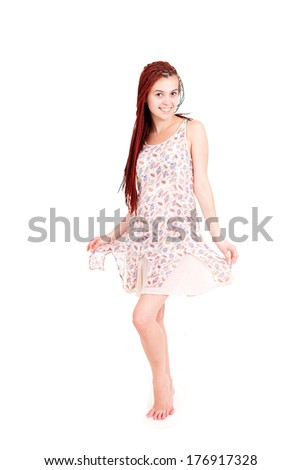 Full length of a happy young lady standing, white background.