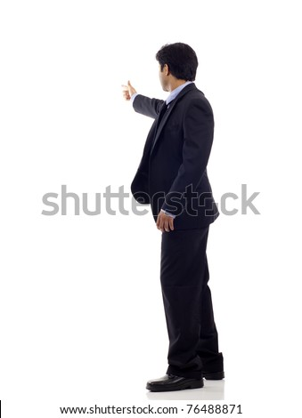 Full length of a Indian business man pointing at copyspace isolated over white background