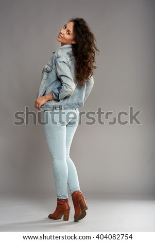 Full length of a native american cowgirl in blue jeans and jacket - stock photo