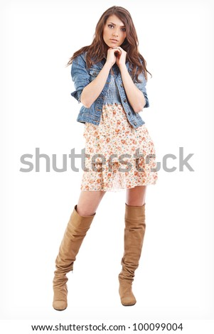 Full length of a pretty young woman posing confidently against bright background - stock photo