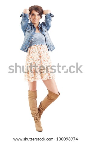 Full length of a pretty young woman posing in white background - stock photo
