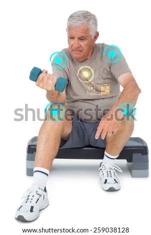Full length of a senior man exercising with dumbbell against fitness interface - stock photo
