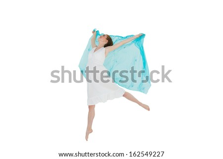 Full length of a young beautiful female dancer with blue scarf against white background