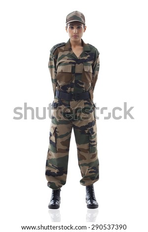 Full length of a young female soldier standing against white background - stock photo