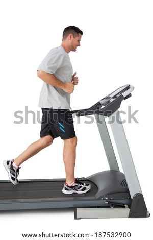 Full length of a young man running on a treadmill over white background - stock photo
