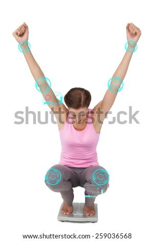 Full length of a young woman cheering on weight scale against fitness interface - stock photo