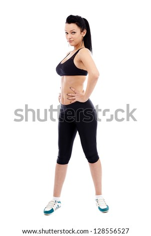 Full length of an athletic young woman exercising, isolated on white