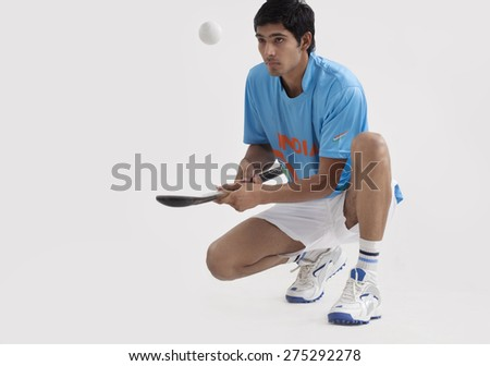 Full length of an Indian man practicing hockey isolated over white background - stock photo