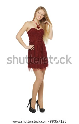Full length of attractive young female in mini dress posing on white background - stock photo