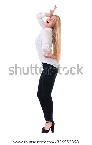 Full length of beautiful blond business woman standing  over isolated white background with copy space - stock photo