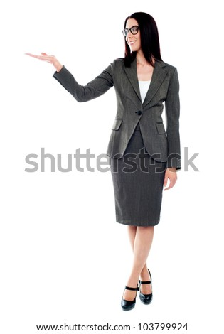 Full length of beautiful business woman showing copy space up over white background