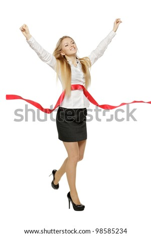 Full length of beautiful businesswoman crossing the finishing line, over white background - stock photo