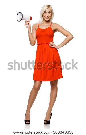 Full length of beautiful female holding loudspeaker, isolated on white background - stock photo