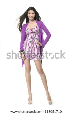 Full length of beautiful female posing in elegant dress - stock photo