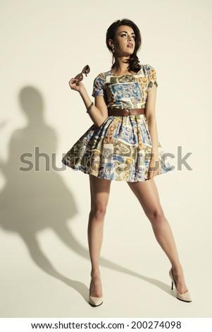 Full length of beautiful female posing in summer dress.   - stock photo